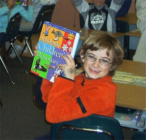 Boy holding dictionary (2003-face-with-dic